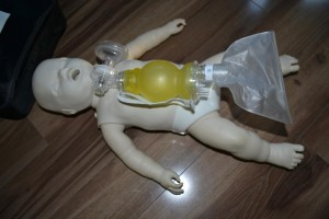 Infant training mannequin and pediatric bag valve mask